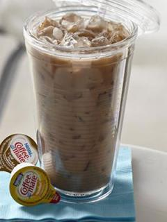 glass of chocolate-hazelnut iced coffee featuring coffee-mate products
